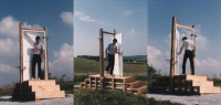 Kalin Serapionov Entrance – Exit 1997 Site-specific installation, wooden construction, door, metal, gravels, 100x300x285 cm. Installation view from the farmer field above the city of Gars am Kamp, Austria 1997