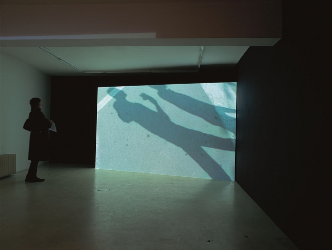 Pavement, 2004 Videoinstallation, DVD, Pal, color, no sound, 15:07 min (looped). Edition of 4 and 1 AP. Installation view in the 41:42 min, Ata Center / Institute of Contemporary Art, Sofia, 2005